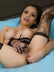Asian ladyboy toying her ass with glass dildo