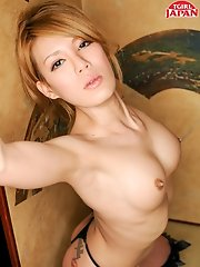 Beautiful Rui Matsushita a hot Japanese tgirl knows how to make you feel great. Watch her strip down and get her nice cock hard for you!